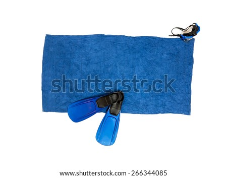 Isolated photo of flippers and snorkeling mask lying on blue beach towel - stock photo