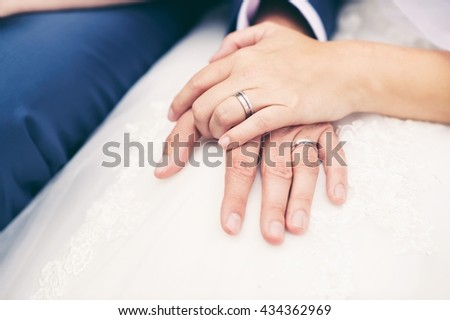 Isolated photo of hands holding together. A beautiful moment of a wedding day - stock photo