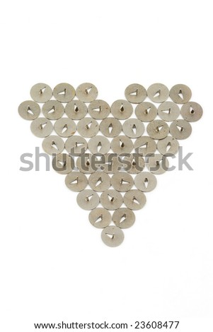 Isolated photo of heart fabricated of pushpins - stock photo
