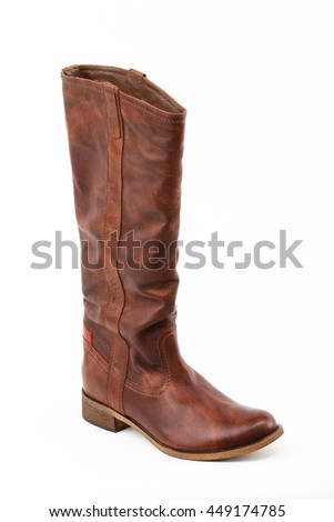 Isolated photo of high, dark brown boots for woman