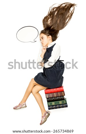 Isolated photo of thoughtful schoolgirl sitting on pile of books - stock photo