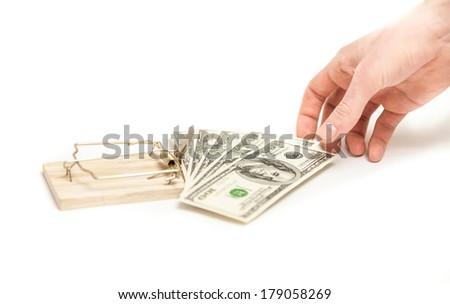 Isolated photo on white of men hand taking money from mouse trap - stock photo