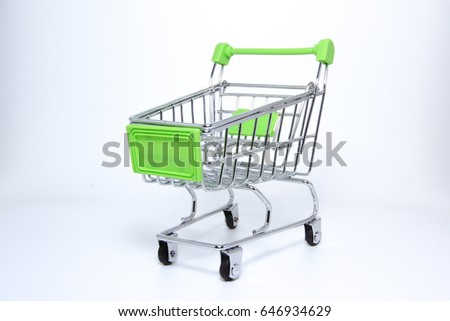 Isolated picture : Mini Supermarket cart.