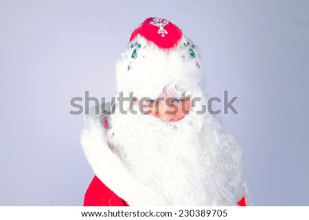 Isolated Picture of Santa Claus with gifts bag with beard in traditional red costume, christmas - stock photo