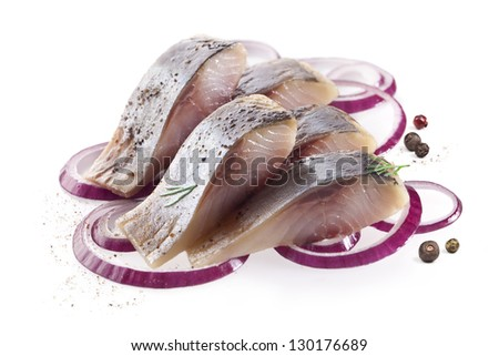 isolated pieces of salt fillet herring with onion - stock photo