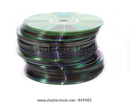 Isolated pile of cds and dvds - stock photo