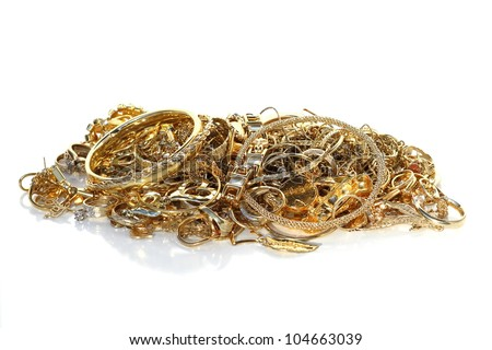 Isolated pile of gold jewelry on white background (chains, necklaces, bracelets, earrings, rings and other scrap gold).