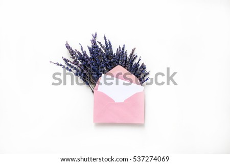Isolated pink envelopes with blue flowers in it. Horizontal studio shot