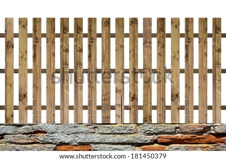 isolated planks fence, old hand made model on scratched bricks - stock photo