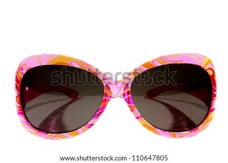Isolated plastic pink girls sunglasses with dark lenses. - stock photo