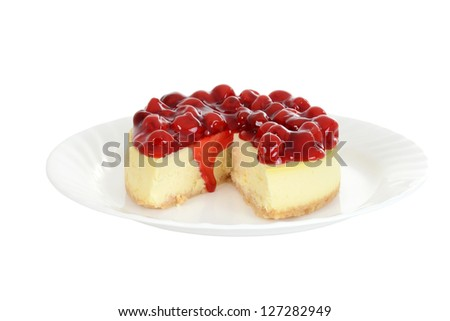 Isolated plate of cherry cheesecake - stock photo