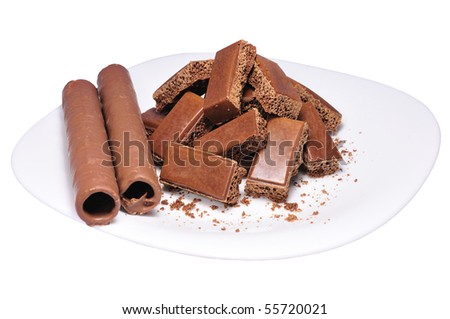 isolated plate with chocolate pieces and tubules - stock photo