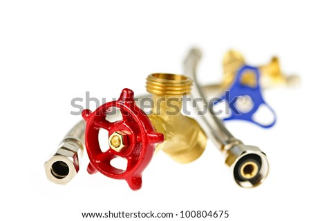 Isolated plumbing valves hoses and assorted parts - stock photo