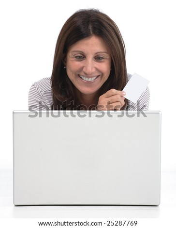 Isolated portrait of a beautiful business  woman using a credit card to buy through internet