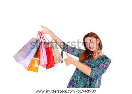 isolated portrait of a beautiful caucasian woman with some shopping bags