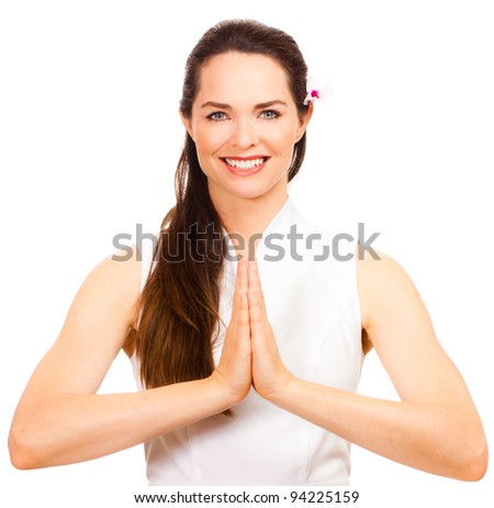 Isolated portrait of a beautiful female massage therapist greeting you welcome. - stock photo