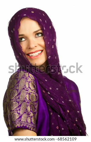 Isolated portrait of a beautiful smiling indian woman in traditional clothing and head scarf - stock photo