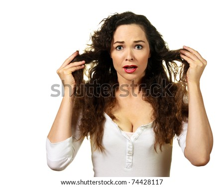 Isolated portrait of a beautiful young woman having a bad hair day - stock photo