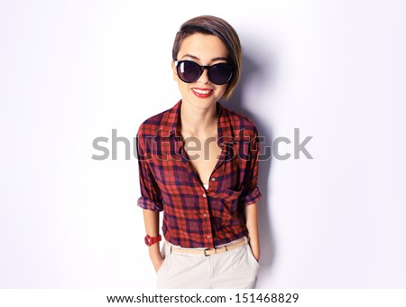 Isolated portrait of a cool girl wearing sunglasses - stock photo