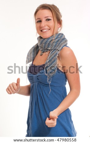 Isolated portrait of a cool young girl with her thumbs up - stock photo