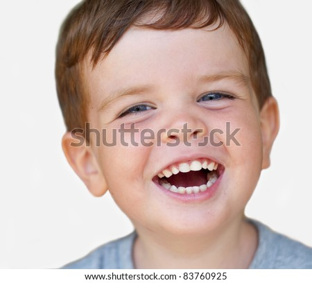 Isolated portrait of a laughing kid with nice teeth - stock photo