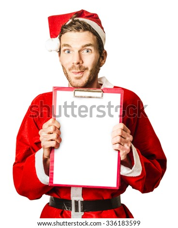 Isolated portrait of a man in santa costume holding christmas wish list with smirk on white background - stock photo