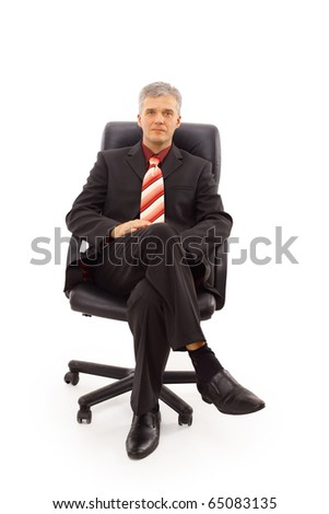 Isolated portrait of a senior businessman sitting on a chair - stock photo