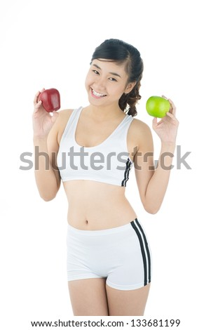 Isolated portrait of a slender girl with apples looking at camera