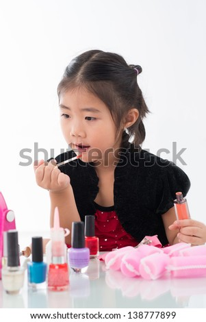 Isolated portrait of a small lady with lip-stick against white background