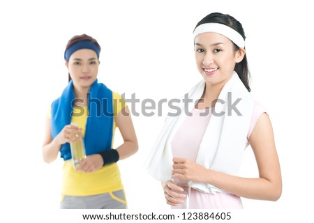 Isolated portrait of active young women after a workout - stock photo
