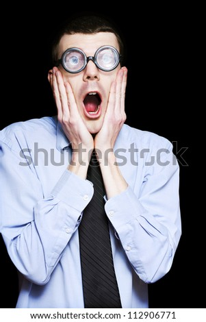 Isolated Portrait Of Astonished Accounting Businessman Gasping For Breath With Hands To Face - stock photo
