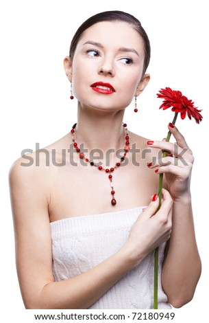 isolated portrait of beautiful brunette girl with red gerbera flower