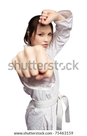 isolated portrait of beautiful martial arts girl in kimono excercising karate kata
