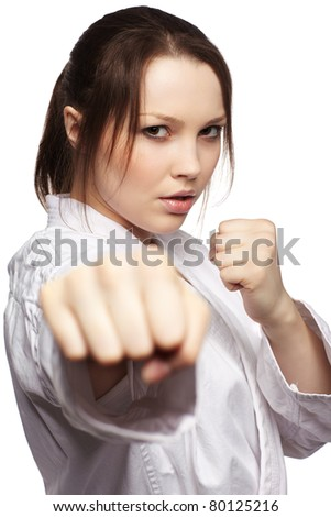 isolated portrait of beautiful martial arts girl in kimono excercising karate kata - stock photo