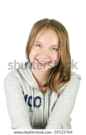 Isolated portrait of beautiful teenage girl listening to earphones - stock photo