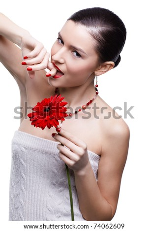 isolated portrait of beautiful tempting brunette girl with red gerbera flower - stock photo