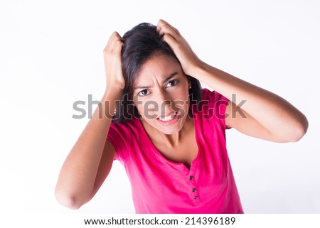 isolated portrait of beautiful young woman angry and upset screaming at camera - stock photo