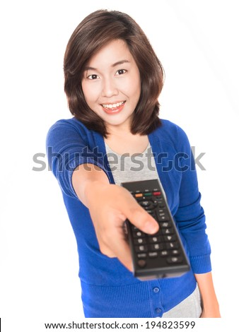 Isolated portrait of beautiful young  woman hold tv remote control and smile on white background. - stock photo