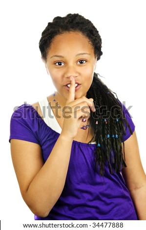 Isolated portrait of black teenage girl gesturing for quiet - stock photo