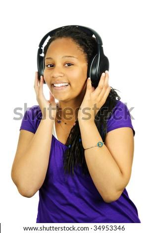 Isolated portrait of black teenage girl listening to headphones - stock photo