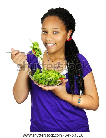 Isolated portrait of black teenage girl with salad bowl - stock photo
