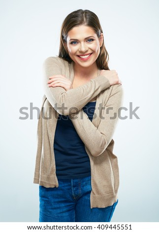 Isolated portrait of casual dressed woman. Smiling positive emotional girl standing against white background. - stock photo
