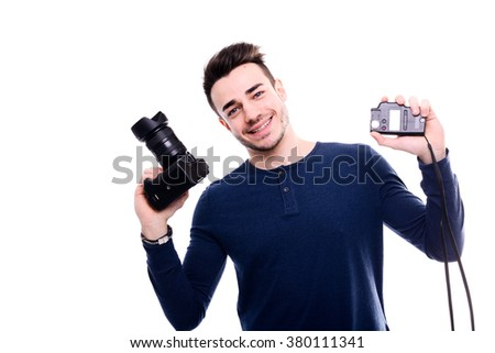 isolated portrait of handsome young man photographer posing and holding a camera
