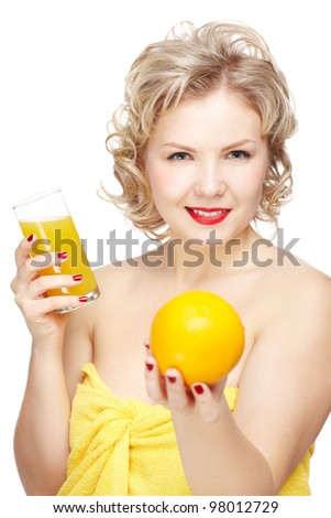 isolated portrait of smiling beautiful young blonde size plus woman model with orange and glass of orange juice in hands