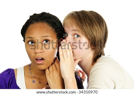 Isolated portrait of two diverse teenage girl friends gossiping - stock photo