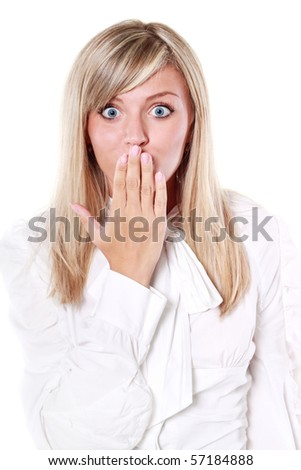 Isolated portrait shot of a beautiful blond woman. Shutting her mouth in astonishment.