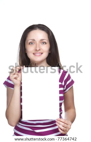 Isolated portrait shot of a beautiful caucasian woman holding a blank white board, signboard, showing an empty bill board against white background.