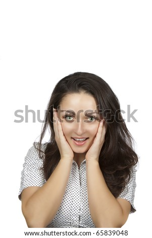 Isolated portrait shot of a beautiful caucasian woman. Holding her face in astonishment.