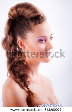 isolated portrait sideview of blonde young girl in elegant whimsical coiffure with sad grey eyes and naked shoulders - stock photo