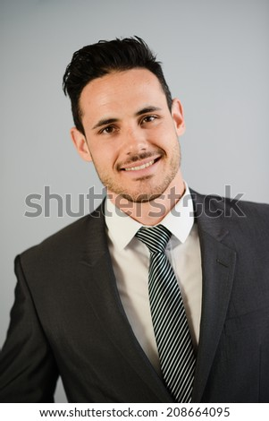 isolated portrait vertical shot of an handsome young businessman on trendy suit - stock photo